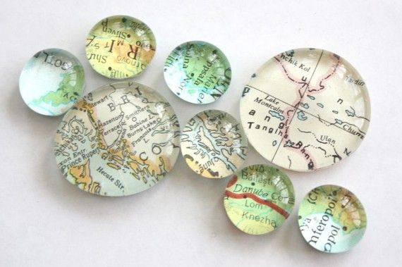 Flat glass marbles + old atlas + magnet = cool map magnets!  Could use vacation spots, hometown, places to go to, etc.