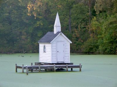On a wooden dock in a pond near Syracuse, New York, sits a teeny-tiny church. The pint-sized house of worship was built in 1989, and is just 3 feet by 6 feet and has only two seats. There are no regular services, but Cross Island Chapel is available for special occasions, like a 1990 wedding in which guests had to sit in boats outdoors. Oneida, New York. why have i never heard of this or seen it?