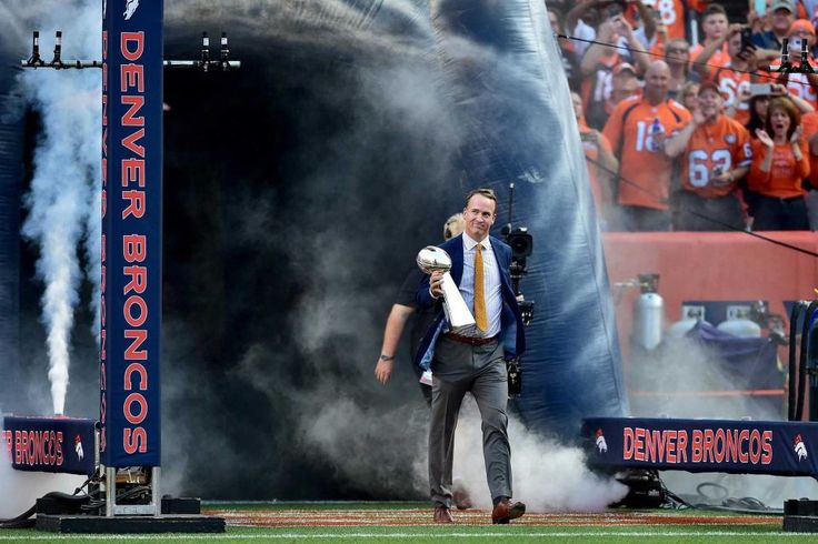 Peyton Manning holds the Lombardi Trophy to celebrate the Denver Broncos in win Super Bowl 50 at Sports Authority Field at Mile High before taking on the Carolina Panthers on Sept. 8, 2016 in Denver.