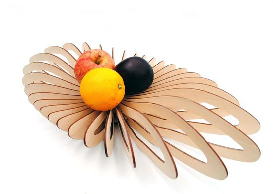 Stunning wooden laser cut bowl. The idea: sitting at the center of a table and holding whatever is in season.