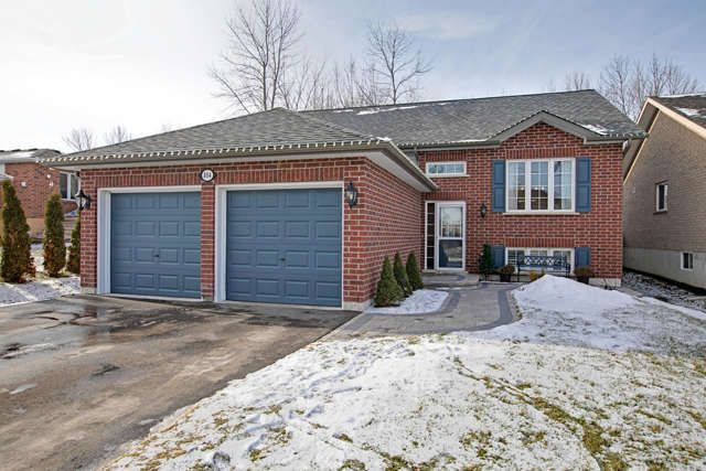 Stunning Newer Built Raised Brick Bungalow Featuring 3+1 Beds, 3 Baths With Gleaming Hardwood Floors And 12 Ft Vaulted Ceiling. Master With 3 Piece Ensuite. Finished Lower Level With Rec Area, 1 Bedroom & 1 Bath. Entry From Foyer Into Two Car Garage.$$ Spent On Landscaping-Walkway, Patio & Firepit. Private Keyed Access To Street Waterfront. Close All Amenities