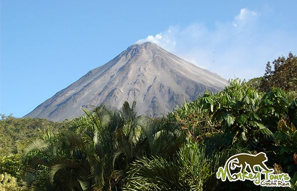 The Arenal Volcano is an iconic figure standing over the landscape of the San Carlos Canton, Alajuela, CostaRica, and as a mirrored image in the waters of Lake Arenal.