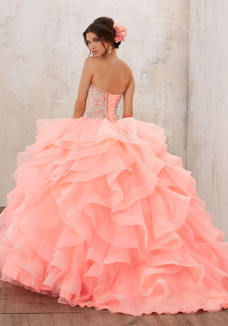 Morilee Quinceanera Dresses  STYLE NUMBER: 89126 Jeweled Beading on a Flounced Organza Ballgown  This Classic Quinceañera Ballgown Perfectly Combines a Stunning Jewel Beaded Sweetheart Bodice, and Full Ruffled Skirt Accented with Delicate Beading. Corset Back. Matching Bolero Jacket Included. Colors Available: Coral/Nude, Champagne/Nude, White/Nude.