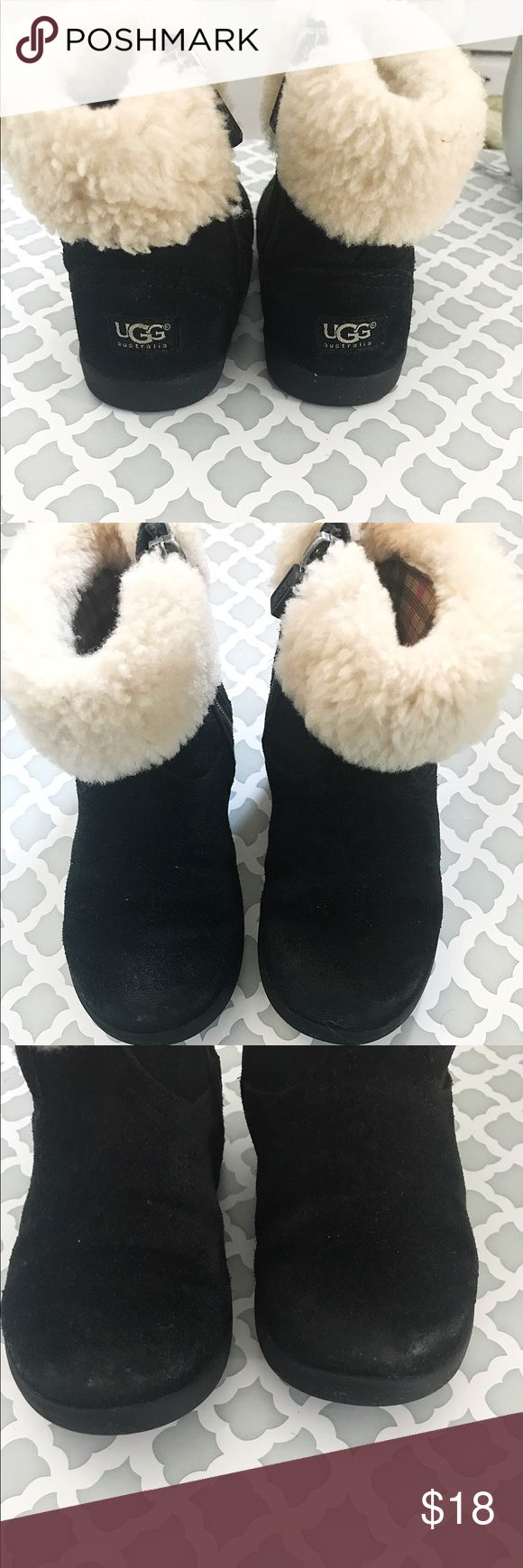 Ugg girls boots Black boots with zipper and sheep fur on top. Boots are on great condition . Has some wear and scuff on the front of the boots like on the toe parts. Perfect for winter . Uggs can be super expensive and it just doesn't make any sense to get them brand new when little ones love to play in the snow during winter and jump into puddles hence they love messing up their shoes  these will be perfect because they can really handle any situation and still be super cute and stylish…