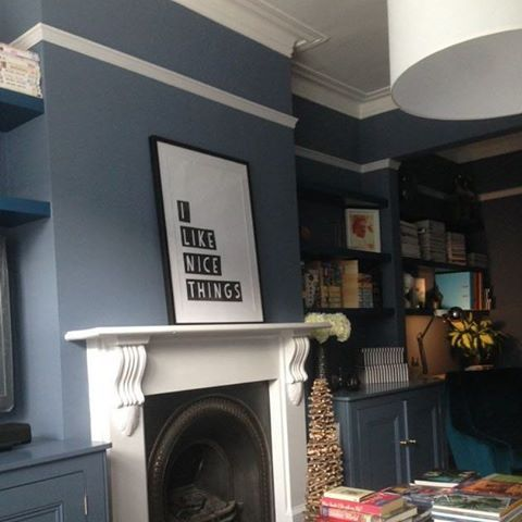 living space using Little Greene's Juniper Ash on the walls, Hicks' Blue on the shelves and Gauze Mid on the woodwork.