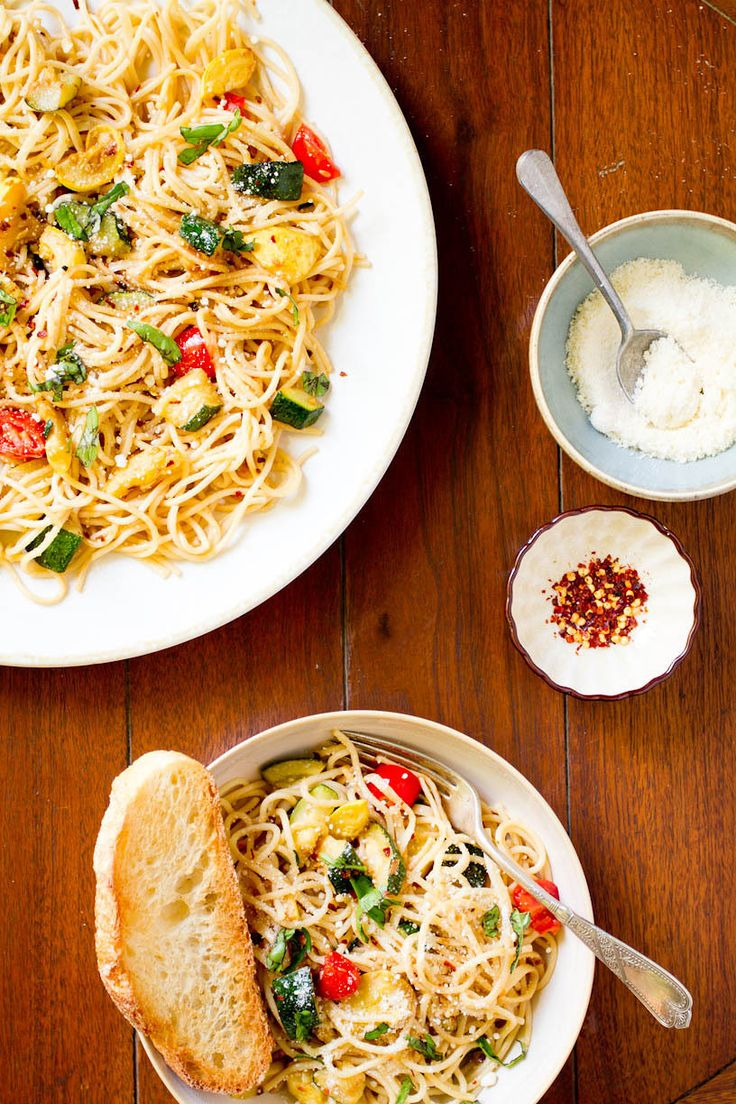 """""""Simple summer spaghetti"""" - olive oil, garlic, zucchini and squash, tomatoes, spices, and parmesan cheese."""