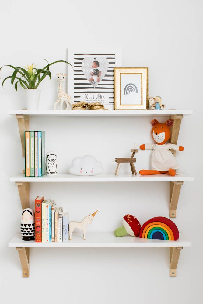 Totally digging the gold brackets on these nursery wall shelves.