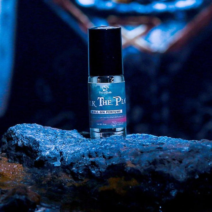 WALK THE PLANK Roll On Perfume Oil - scents of oak aged bourbon, fresh grown Caribbean sugar cane, sparkling pomelo, dried tobacco sprinkled with mandarin zest