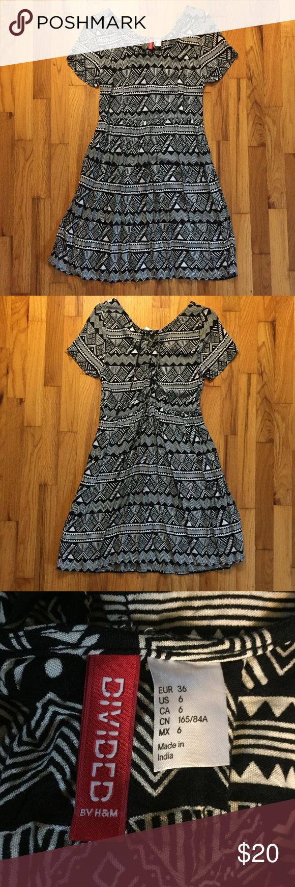 NWOT Aztec Print Dress Never worn! Brand new super cute Aztec print dress with lace up back detail. Divided Dresses