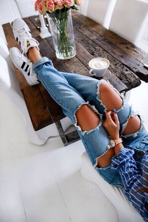 Striped shirt + Ripped jeans + Adidas Superstar sneakers in White/Black.