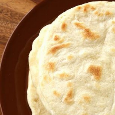 Flour Tortilla Recipe Ingredients 2	cups flour ( you can get creative with your flour choices like whole wheat, spelt, soy, or a mixture of flours) ½	teaspoon salt ¼	cup vegetable shortening or ¼ cup vegetable oil 1	teaspoon baking powder ½	cup warm water (may possibly need to add more, up to ¾ cup) or ½ cup milk ( may possibly need to add more, up to ¾ cup)