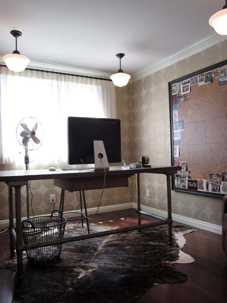 A Home Office With An Industrial Style Desk Is Anchored By Animal Hide Rug Over Sized Bulletin Board Cork Tiles Bordered Personal