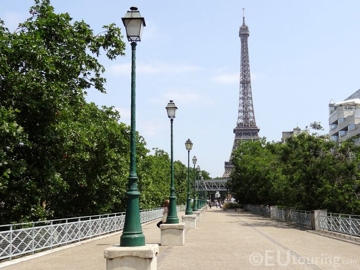 A view of the Eiffel Tower in Paris from in a little secluded place over some train lines, perfect for a place to have a break and relax.  http://www.eutouring.com/