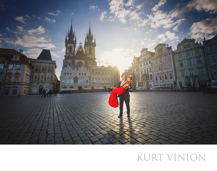 London wedding & Prague pre wedding photographer - A Prague wedding proposal: L&G share a moment in Prague's historic Old Town Square after his surprise wedding proposal on the Charles Bridge. Keywords: Prague Engagement Photography (24).