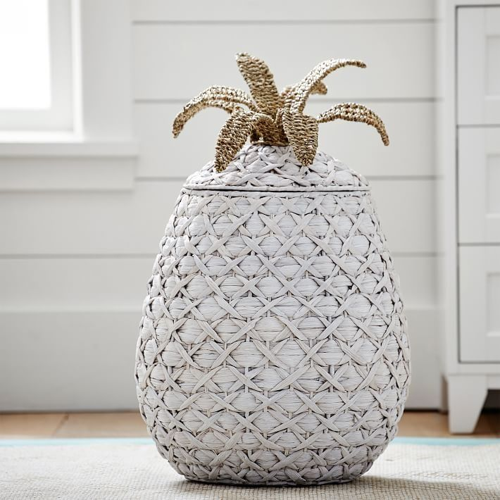 Pineapple Catchall Why not choose a catchall that embodies your fun and vibrant style? This cheery pineapple adds welcoming warmth and personality to your favorite space. Plus, it has a supersoft liner so it can be used as a hamper, as well!