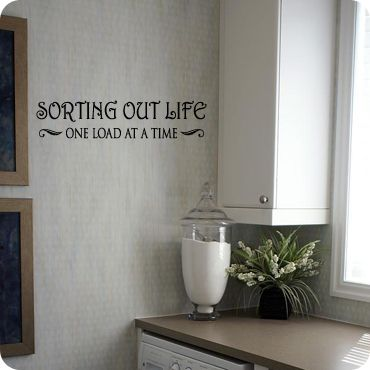 Think this would be cute for my laundry room! Sorting Out Life (wall decal from WallWritten.com).