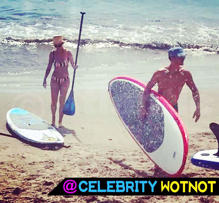 Back together? Katy Perry put on a bikini and joined a toned Orlando Bloom on a beach in California to go paddleboarding! © Atlantic Images