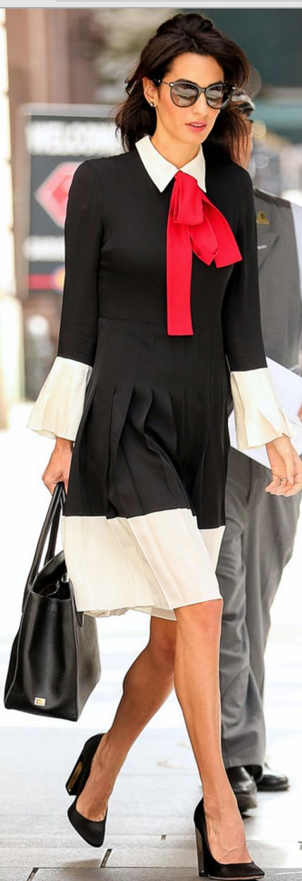 Who made Amal Clooney's black, white, and red bow pleated dress, black sunglasses, and pumps?