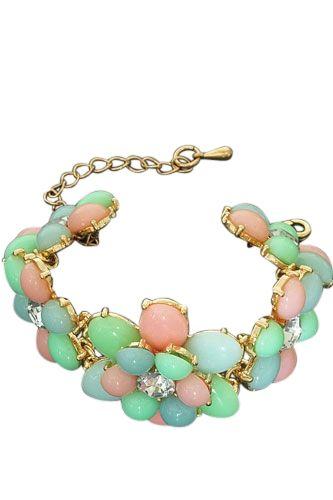 Mooie pastelkleur statement armband , bloemen gevormd van blauw/roze/groene steentjes met een strass steen in het midden. - € 9,95