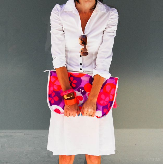 Big clutch purse made from an old dress and a garment bag.