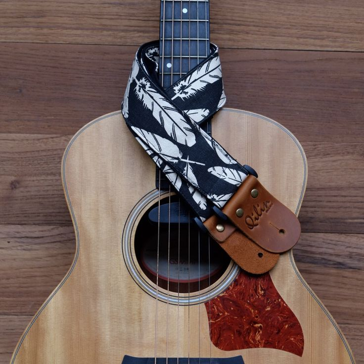 A personal favorite from my Etsy shop https://www.etsy.com/listing/256373249/black-vane-guitar-strap