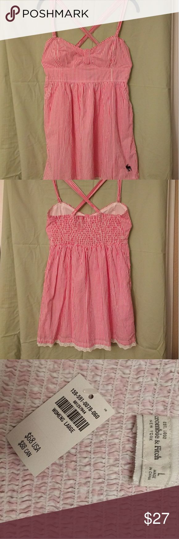 Pink and white dress Pink and white Abercrombie and Fitch dress brand new!! Has cute little moose at bottom hem in navy blue. Also has pockets! Very adorable. Abercrombie & Fitch Dresses Mini