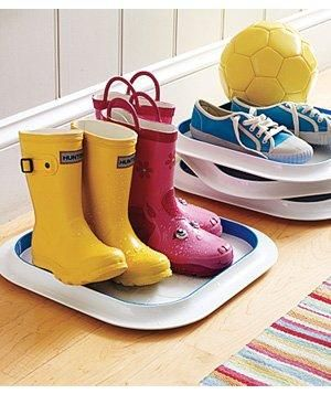 Use plastic serving trays to control the clutter and prevent puddles from damaging hardwood floors.