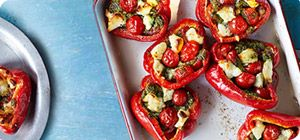 Serve up these healthy red peppers stuffed with pesto and halloumi.