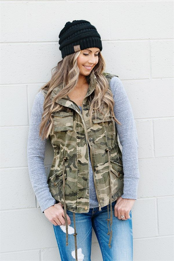 These camo print military style vests are a must-have for your Fall and Winter wardrobe. Vest features a detachable hood, two chest pockets, a cinch waist, and two side pockets.