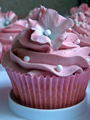 rasberry frosting and pink flowers