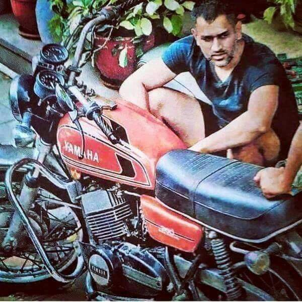 Dhoni with his first bike, which he purchased during his early days in Cricket world. And still taking care of it.