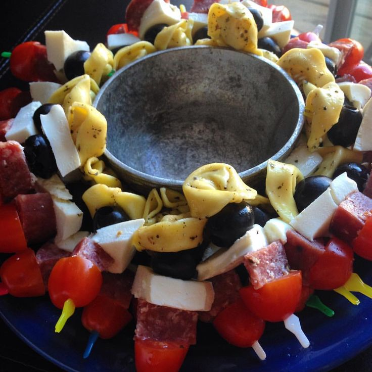 These are one of my favorite appetizers to bring (and mini skewers of any type!) spinach tortellini, olive, fresh mozzarella, hard salami, and tomatoes. The center will have homemade balsamic vinaigrette You could easily make ones whole 30 by adding grilled chicken and other vegetables (roasted red pepper, artichokes etc).