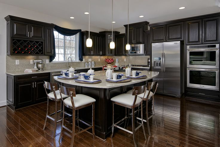 What a unique kitchen island for gathering!  We love open concept kitchens - #ModelHome, #kitchen, #kitchenisland Stanley Martin Homes