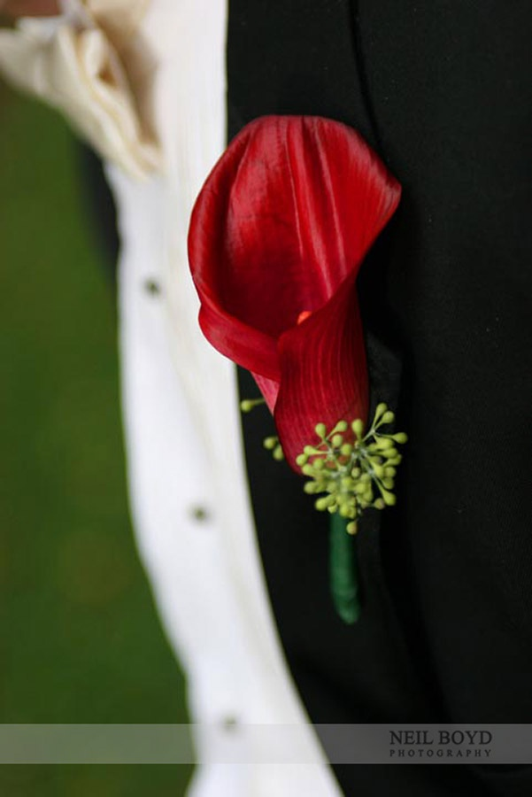 Red wedding boutonniere.
