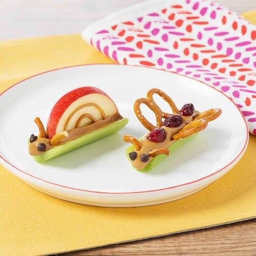 Adorable healthy bug treats for kids made with apples, raisins, peanut butter, celery, and pretzels