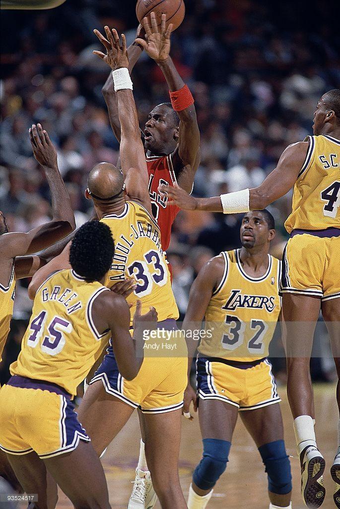 Chicago Bulls Michael Jordan (23) in action, taking shot vs Los Angeles Lakers Kareem Abdul-Jabbar (33). Inglewood, CA 2/4/1988