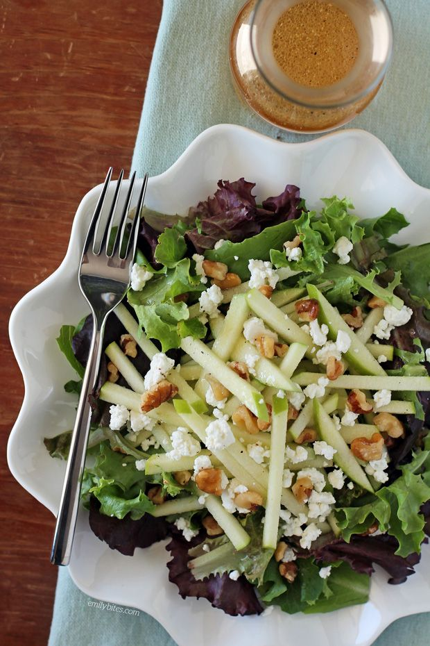 This Harvest Apple Salad is light, fresh & perfect for Fall with creamy goat cheese, earthy walnuts, tart Granny Smith apple and an Apple Cider Vinaigrette! Just 136 calories or 4 Weight Watchers points. www.emilybites.com