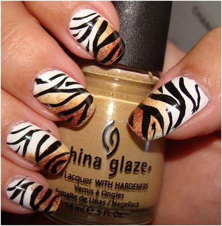 Tiger themed nails - paint the nail white and do brown ombre. Then make tiger stripes in black.