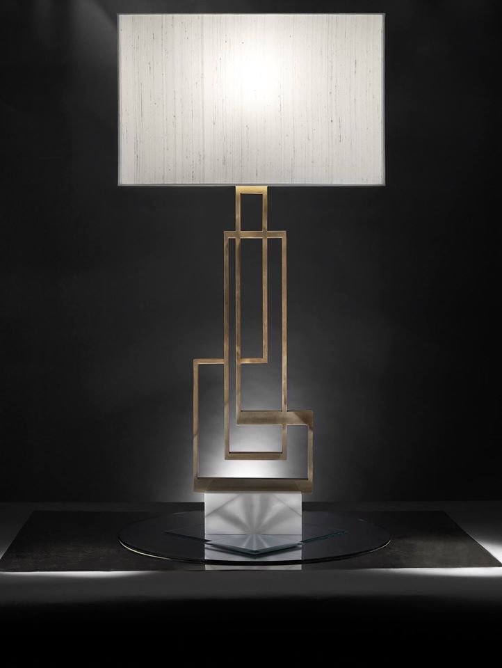 """The Lychnos Collection by #TwoIsCompany is inspired by mankind's eternal battle against darkness. Each light source is designed with the glow of fire in mind, brilliantly extending the day into the night. Each object is a geometric homage to the photon concept, an elementary particle that burns bright with energy, a massless messenger that darkness has finally come to an end. """"Ilios"""" table lamps with geometric pattern in oxidized bronze and solid marble base."""