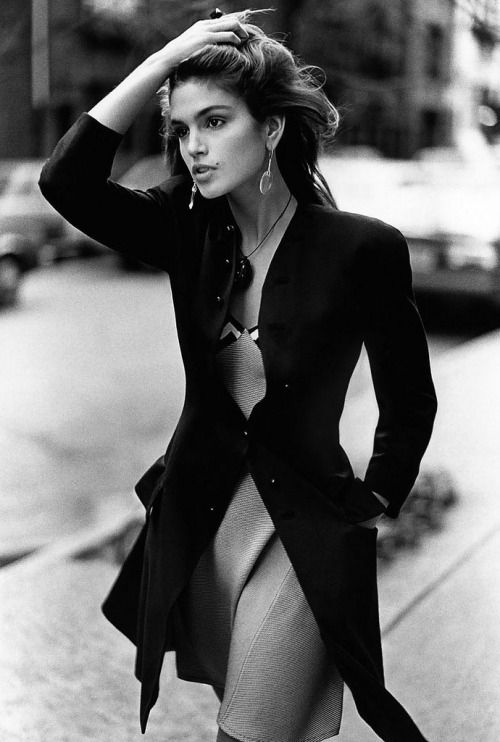 Cindy Crawford, wearing a fitted black wool coat over a striped silk slip-dress by Gianni Versace, photographed by Arthur Elgort for Vogue US February 1988 #blog #blogger #versace #cindycrawford #models #supermodels #fashion #style #vogue #photography http://www.midnight-charm.com/