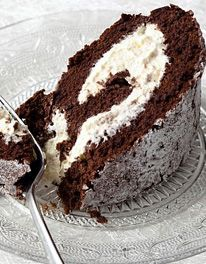The Ultimate Chocolate Roulade. This recipe is taken from: Baking Bible by Mary Berry. Ingredients: 175g plain chocolate, such as Bourneville 175g caster sugar 6 large eggs, separated 2 tbsp cocoa powder, sifted. The filling is whipped cream