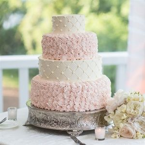 The couple's intricate cake featured alternating pink and white tiers with buttercream patterns.