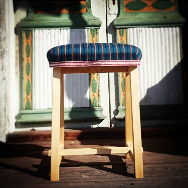 """The stool """"Bollnäs"""" is made from Swedish birch wood. The fabric borrows its pattern from the local folk costume of the Bollnäs area."""
