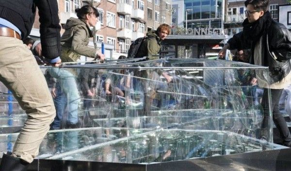 "The ""Bubble Building"". Designed by DUS Architects for the ZigZagCity festival in Rotterdam, the pavilion is the world's most temporary and fragile structure, comprised of 16 shallow hexagonal pools, each of which is filled with a reflective solution, that collectively form 35 square meters of ""soap surface""."