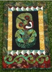 NZ Tiki wallhanging. Designed by Mary Metcalf The NZ maori tiki is often regarded as a good luck charm and in some areas as a fertility symbol.