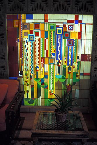 This back-lit geometric stained glass mural by Frank Lloyd Wright  is in the foyer of the Arizona Biltmore. It was originally