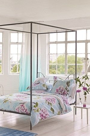 Beautifully hand-drawn floral sprays scatter over a beautiful soft aqua background in this vivacious printed bed.  Magenta petals mix with leaves of soft jade and lime, and are framed by the characterful charcoal illustrations.