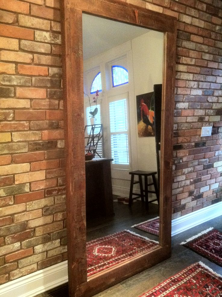 Rustic, reclaimed wood full length mirror. Goes great with the exposed brick in this hallway, right?