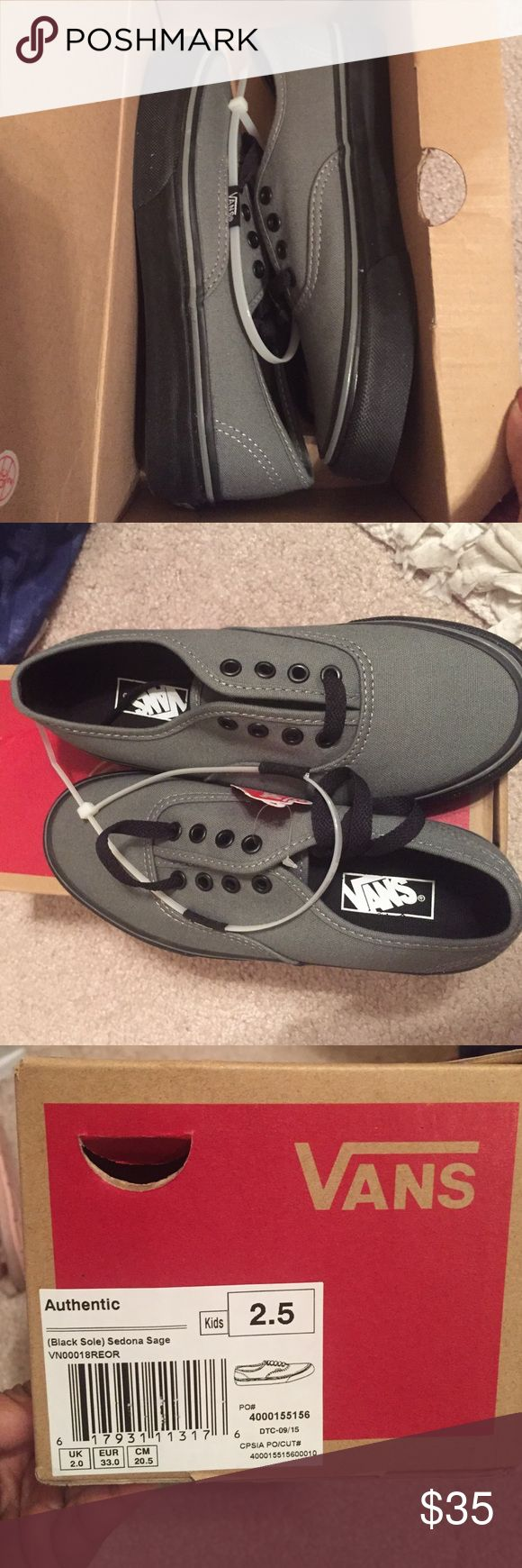 Authentic vans boys 2.5 Nice gray and black vans for boys size 2.5. New with tags Vans Shoes Sneakers