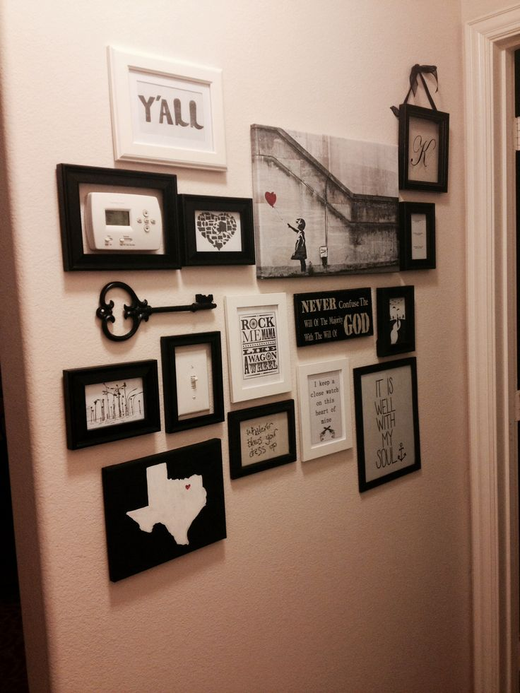 Love how the collage wall just frames the thermostat and light switch into the mix.